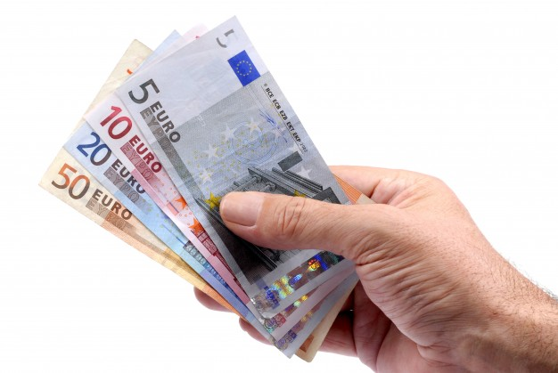 hand-holding-euros-currency_1101-411.jpg